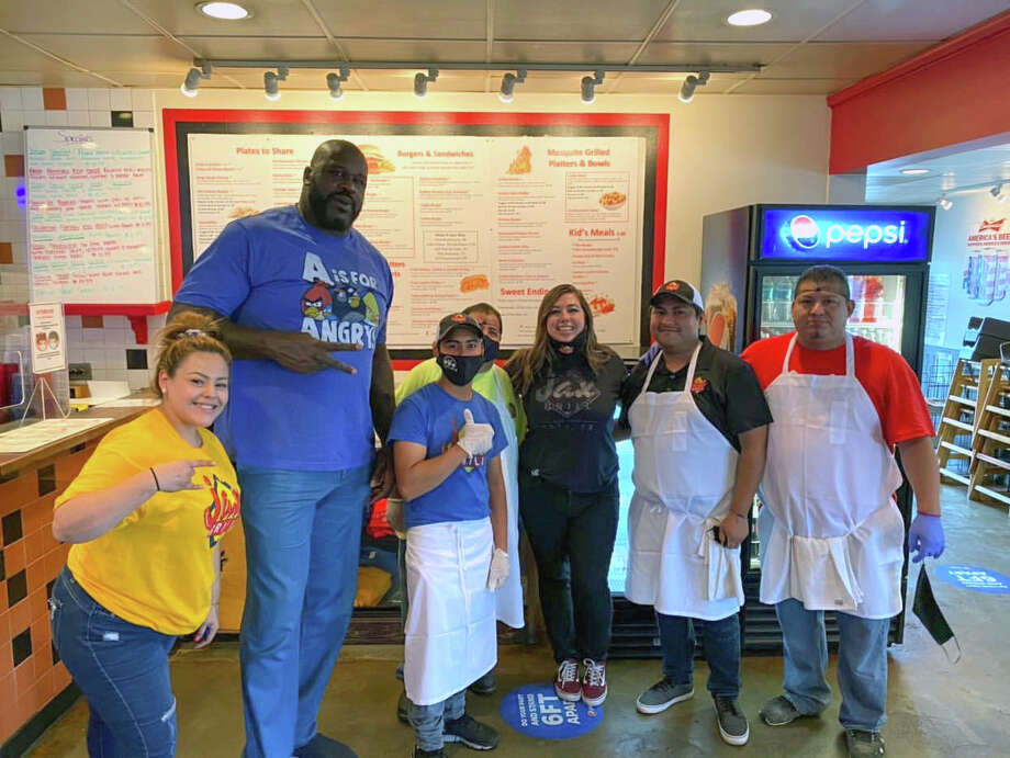 Shaquille O'Neal had dinner at Jax Grill this week. Photo: O'Neal posed with the staff at Jax Grill, who removed their face masks only for the photo. Photo: Kenneth Miles