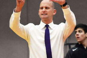 Edwardsville coach Dustin Battas took the Tigers from a 20-loss season in his first year as head coach to a 23-win season in Year 2 and is the 2020 Telegraph Large-Schools Boys Basketball Coach of the Year.