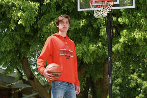 Edwardsville's Brennan Weller, shown on his home court outside his house in Edwardsville, is the 2020 Telegraph Large-Schools Boys Basketball Player of the Year.