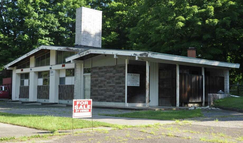 The gas station on Wilton Road West in the middle of a residential area has been empty for years, and is being offered for sale. Photo: Macklin Reid / Hearst Connecticut Media