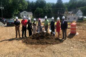 Officials of Ion Bank take part in a ground breaking ceremony for the Naugatuck-based bank's second Farmington branch.