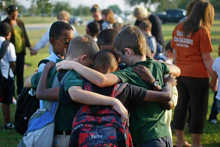 A group Eagle Heights Christian Academy pray in 2012. The Pearland private school will have its first day of school on Aug. 24 and offer face-to-face and virtual instruction. Photo: Johnny Hanson, Staff / Houston Chronicle / © 2012  Houston Chronicle