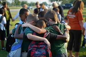 A group Eagle Heights Christian Academy pray in 2012. The Pearland private school will have its first day of school on Aug. 24 and offer face-to-face and virtual instruction.