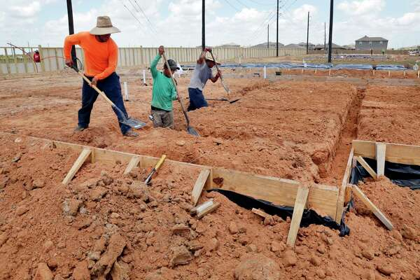 Contract workers prep foundations before concrete is poured as home construction continues in the Freeman Ranch subdivision in Katy. . Some 800 homes will eventually be built in the subdivsion by The Woolands homebuilder LGI Homes. LGI Homes vaulted into the Chronicle 100's top 10.