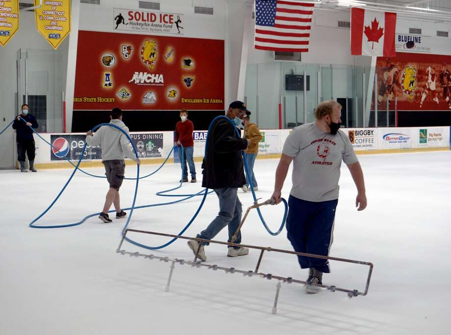 While it has been closed to the public for months, workers and volunteers laid down and meticulously painted a new sheet  of ice at Ewigleben Arena. When the doors are allowed to open, it will be skater-approved. Photo: Pioneer Photos/Joe Judd