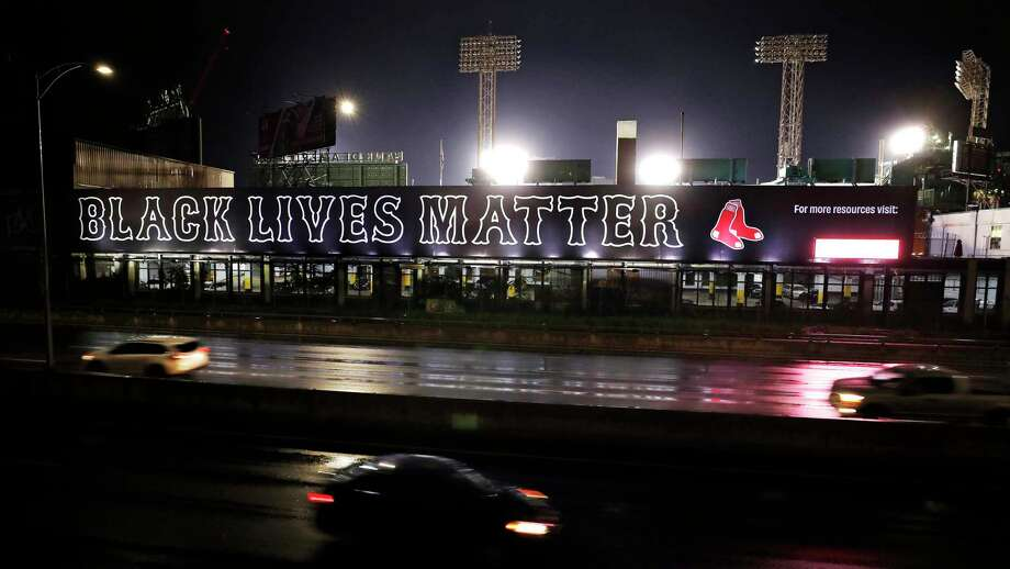 "Cars along the Massachusetts Turnpike drive past a giant ""Black Lives Matter"" mural, Wednesday evening, July 22, 2020, outside Fenway Park, at the rear, in Boston. (AP Photo/Charles Krupa) Photo: Charles Krupa, Associated Press / Copyright 2020 The Associated Press. All rights reserved."