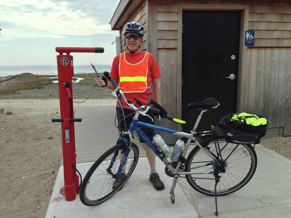 Tim Bezler, a Fairfield resident, using the bike pump installed at Southport Beach.