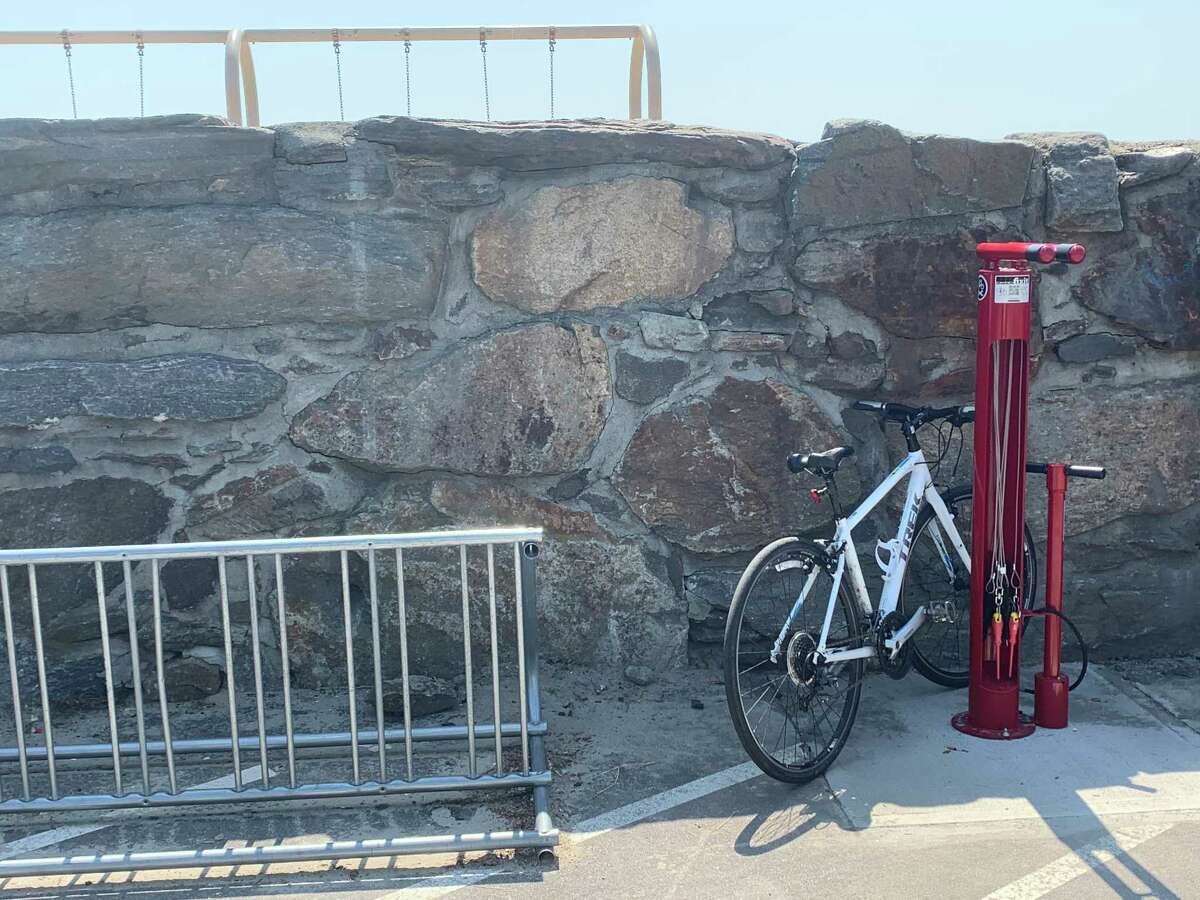 A bike rack and repair station installed at Penfield Beach.