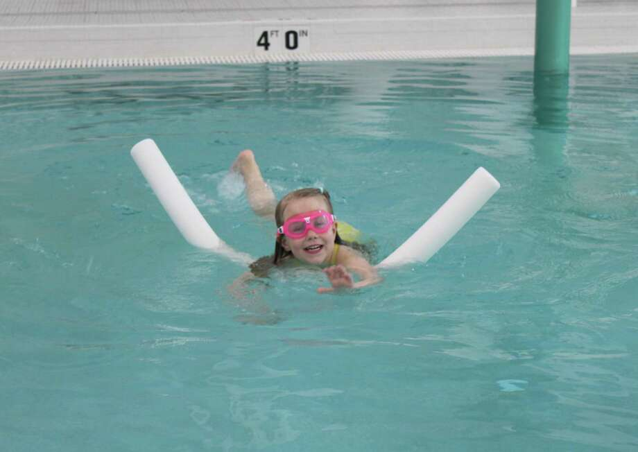 The New Canaan YMCA is offering private, semi-private, and small group parent/child swim lessons over the course of a 5-week session. Photo: New Canaan YMCA