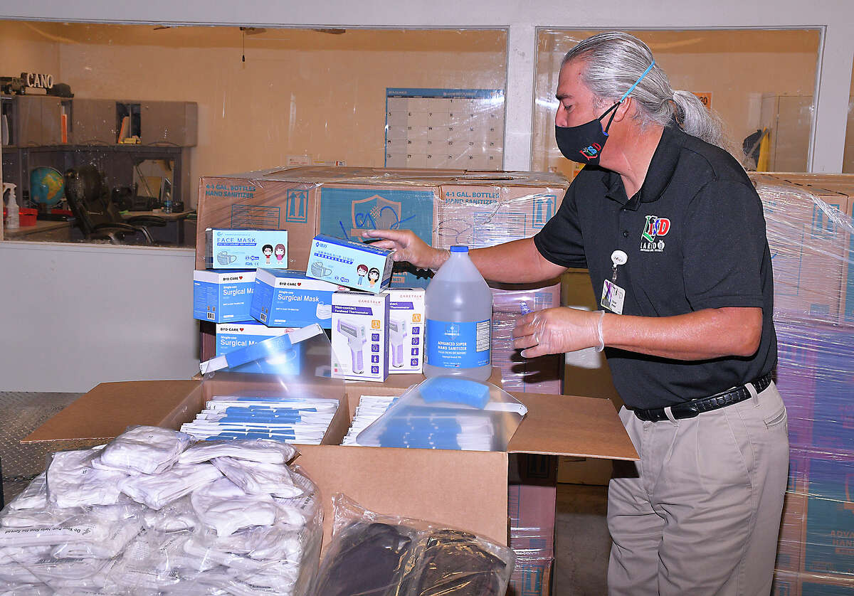 Assistant Superintendent for Accountability, Compliance and School Safety at LISD, Oscar Perez, shows some of the COVID-19 related personal protective gear provided by the state for LISD schools and departments, Wednesday, July 22, 2020 at the LISD Central Receiving Warehouse. The delivery included face coverings/mask for children and adults, hand sanitizing lotions and face shields.