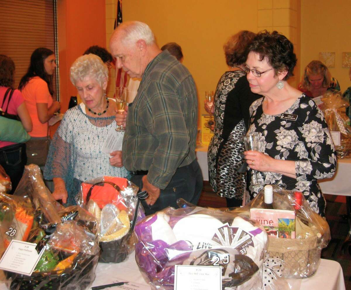Guests interact at a previous year's gala. The annual event, which has been canceled this year, typically serves as a way to showcase the library while raising money for a variety of projects. (Courtesy photo)