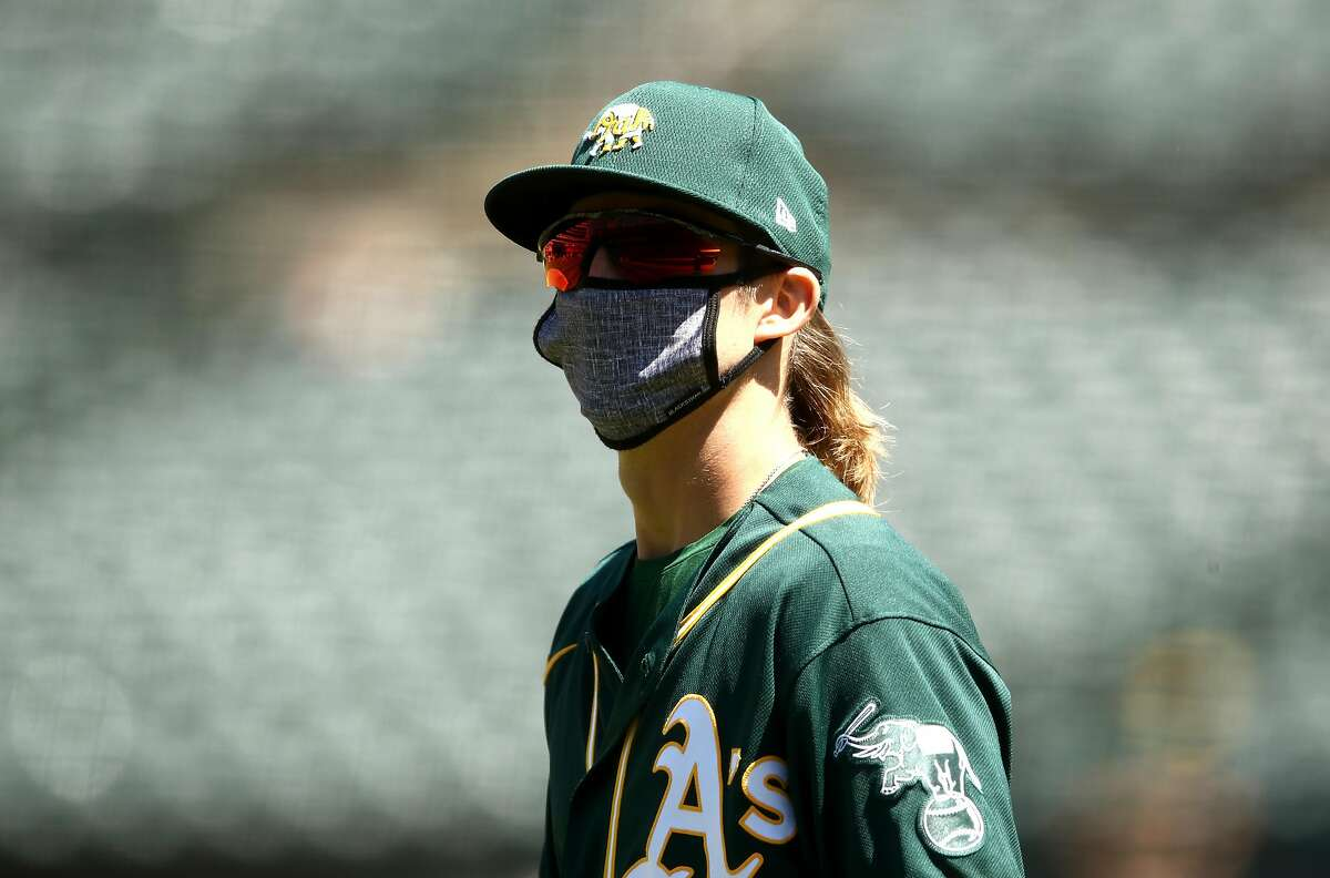 OAKLAND, CALIFORNIA - JULY 05: Daniel Gossett #32 of the Oakland Athletics wears his mask during summer workouts at RingCentral Coliseum on July 05, 2020 in Oakland, California. (Photo by Ezra Shaw/Getty Images)