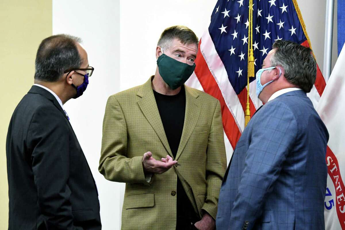 University at Albany president Havidan Rodriguez, left, and Siena College president Christopher Gibson, center, confer with Albany County Executive Dan McCoy, right, ahead of the county's coronavirus briefing on Thursday, July 23, 2020, at the county offices in Albany, N.Y. (Will Waldron/Times Union)