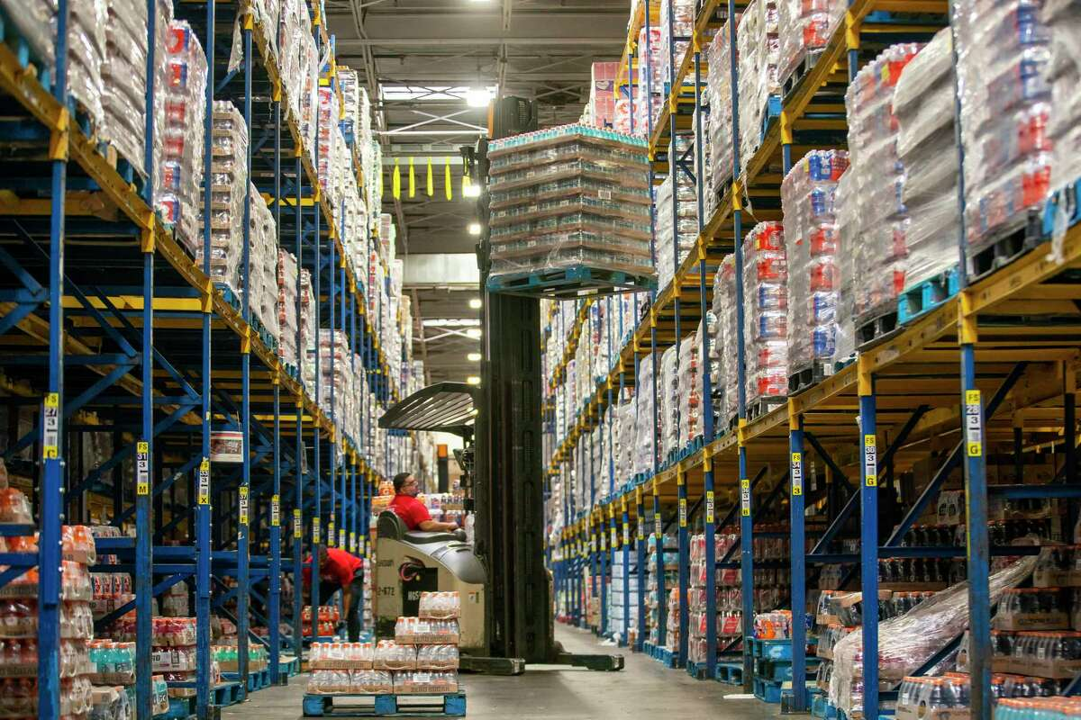 Workers inside HEB's Houston retail support center, the warehouse and distribution center that serves the entire Houston region, move product through the center Friday, March 13, 2020, in northwest Houston. The center has been moving nearly twice the number of pallets a day to meet the increased demand from HEB's retail stores.