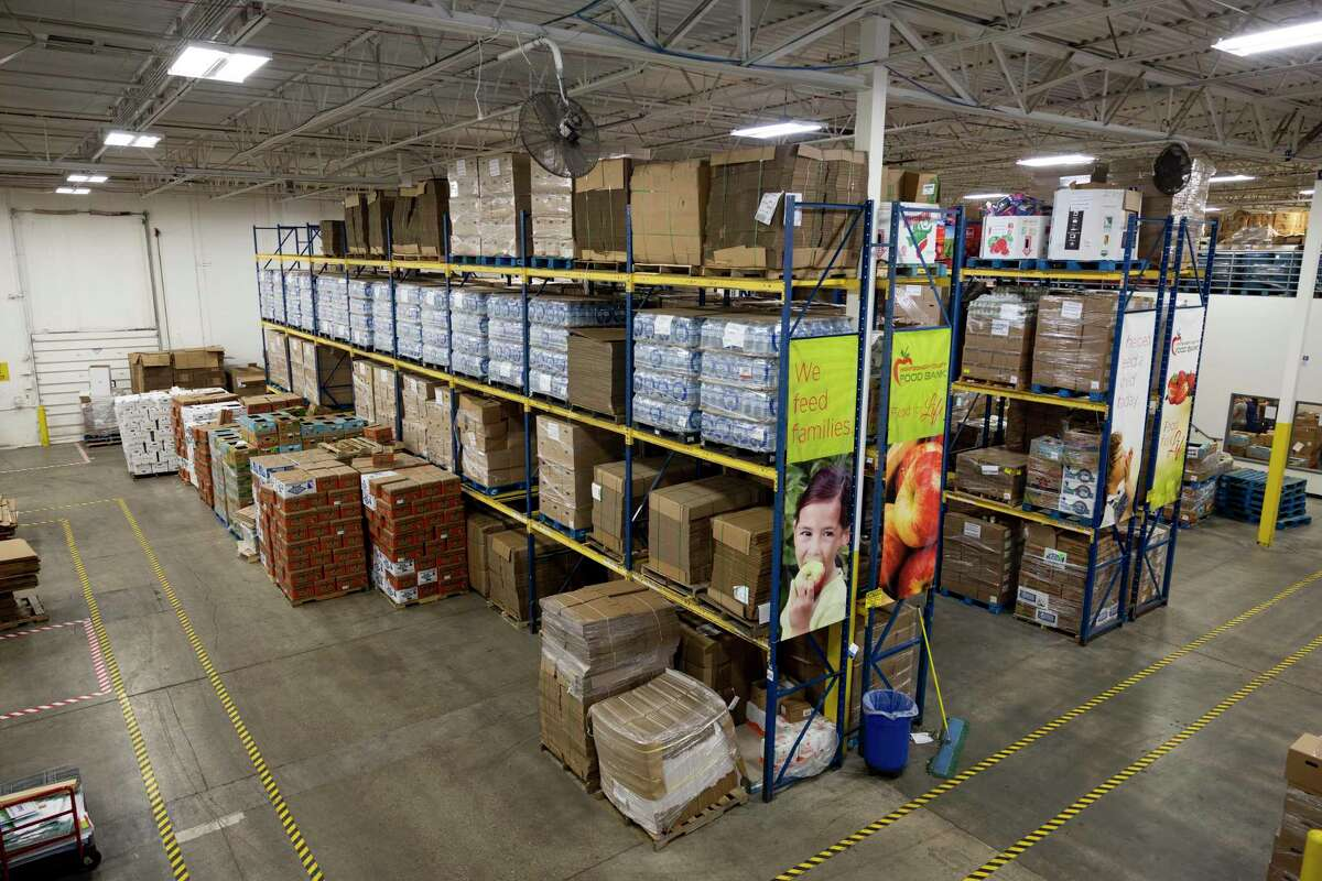 Pallets of food was stacked on shelves at the Montgomery County Food Bank in Conroe, Tuesday, July 21, 2020. The food bank is in need of volunteers after the National Guard was called back to their posts.