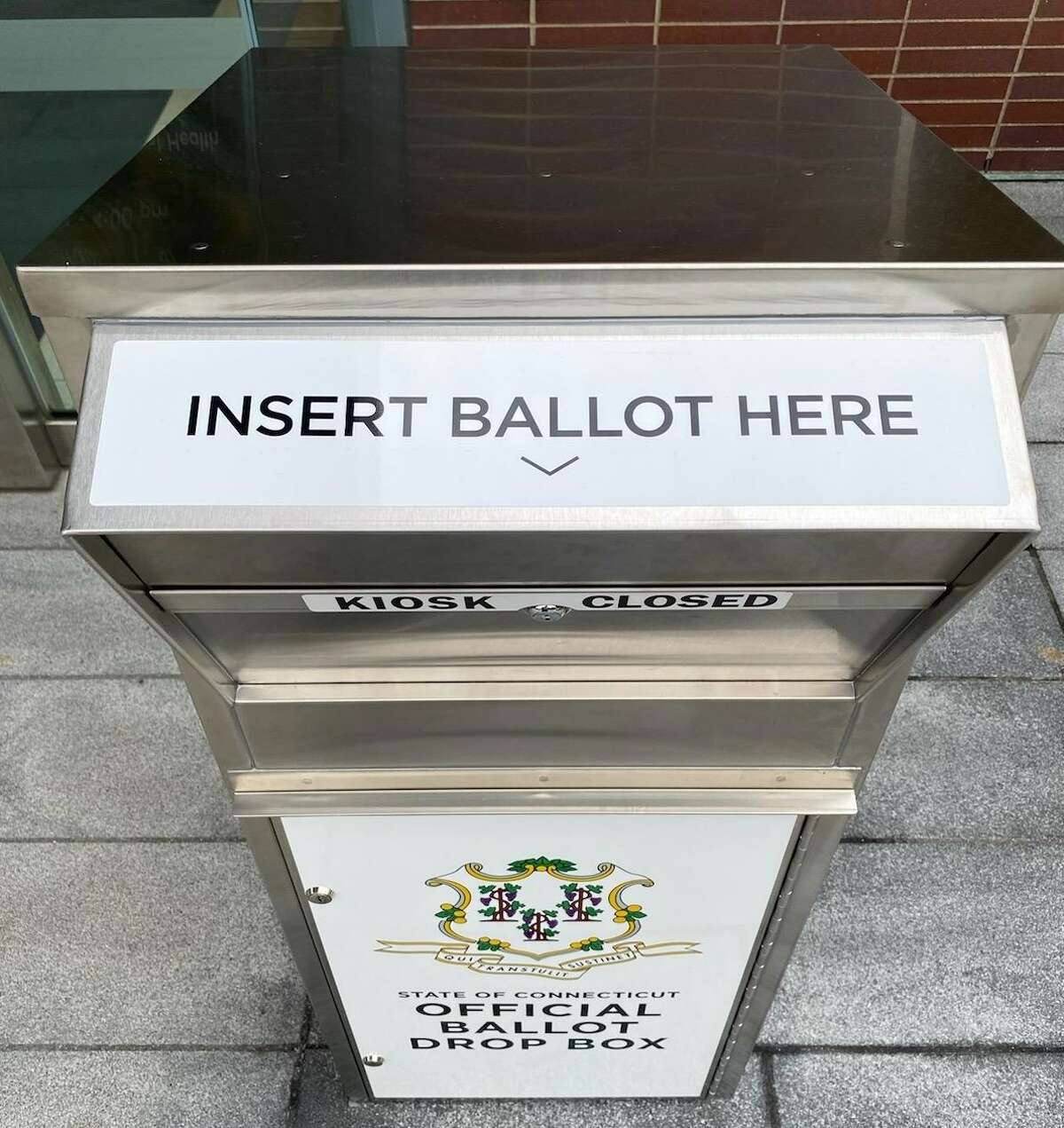 A drop box outside New Canaan Town Hall awaits applications for absentee ballots for the Nov. 3 election, as well as the completed ballots themselves.