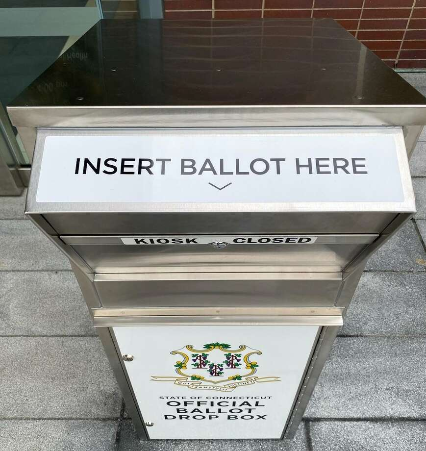 A drop box outside New Canaan Town Hall awaits applications for absentee ballots for the Nov. 3 election, as well as the completed ballots themselves. Photo: Grace Duffield / Hearst Connecticut Media