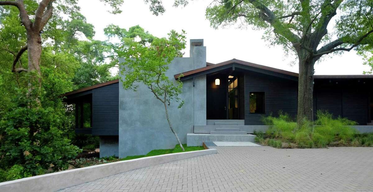 The exterior of this home on Tiel way is similar to the original structure on the site. The first home here was designed by Karl Kamrath in 1961 and was considered a midcentury gem. It was demolished in 2017, and its replacement -- by Robertson Design -- is finally finished.