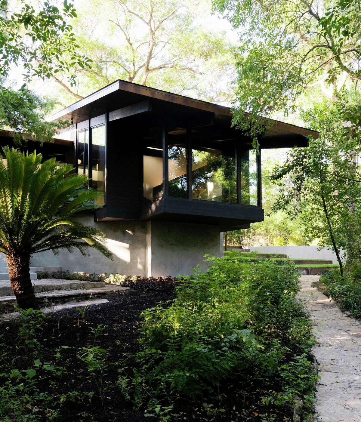 Architects Christopher Robertson and Vivi Nguyen Robertson of Robertson Design recreated this cantilevered room on the back of the home. It's huge windows make you feel like you're in a treehouse.