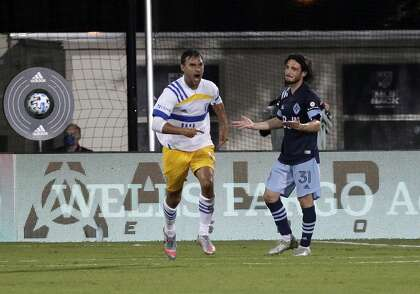 Earthquakes forward Chris Wondolowski (left) grew up in the East Bay. He has more goals than any player in MLS history.