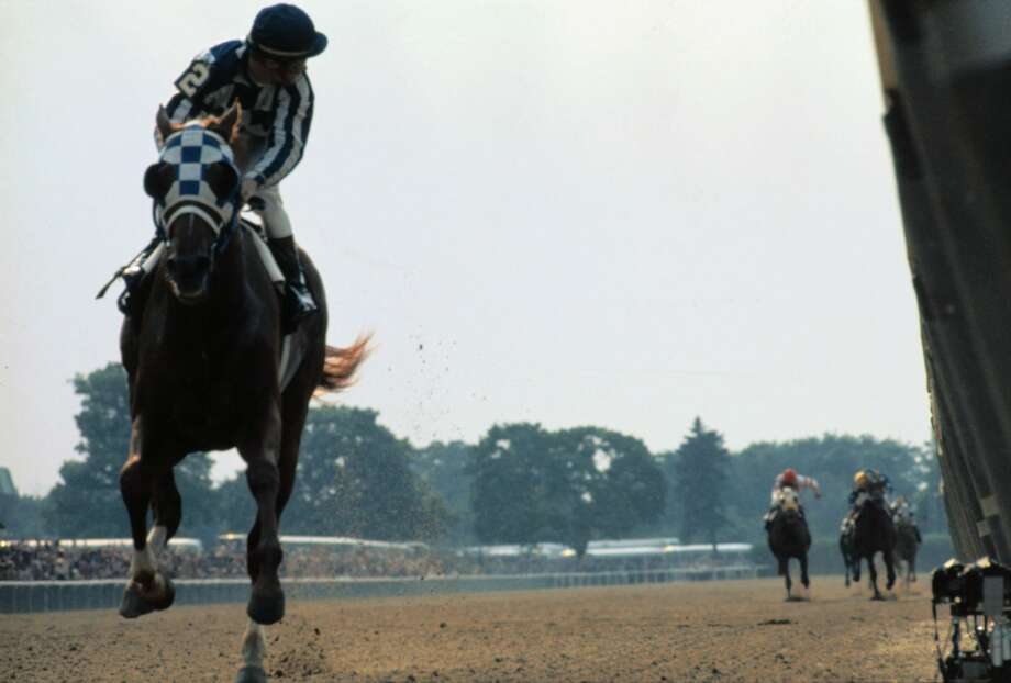 Jockey Ron Turcotte glances over his shoulder at the horses Secretariat has left in the dust during his 31-length victory in the Belmont Stakes on June 9, 1973. Photo: Getty Images