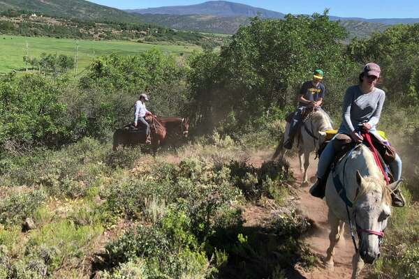 The author's kids horseback riding at Snowmass Creek Outfitters' ranch.