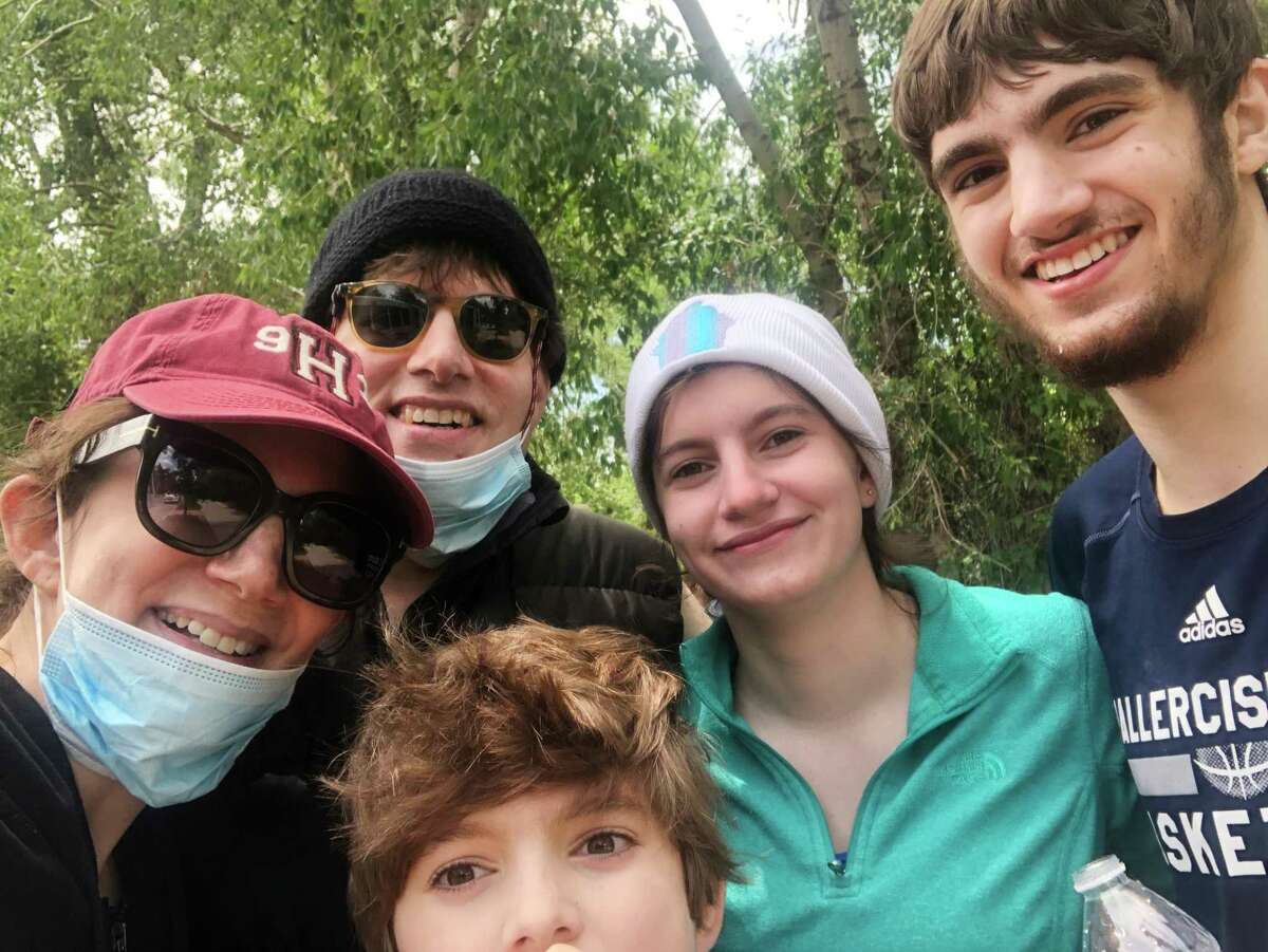 From left, author Johanna Berkman, her husband and fellow camp director, Manny Weintraub, and their three children in a post-rafting selfie.