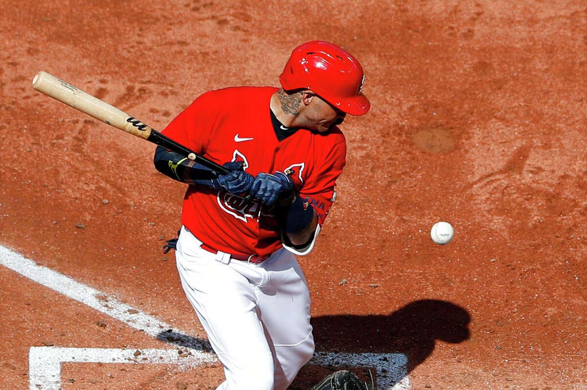 St. Louis Cardinals catcher, Yadier Molina, takes an inside pitch at Busch Stadium.