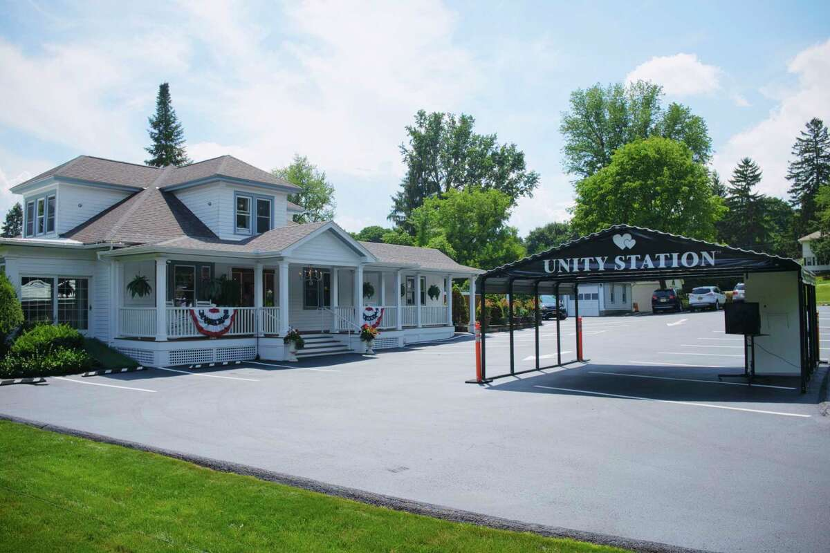 A view of Townley and Wheeler Funeral Home with the outside shelter on Thursday, July 23, 2020, in Ballston Lake, N.Y. The shelter, called Unity Station, allows for people in their vehicles to virtually connect through a monitor to family members inside the funeral home. (Paul Buckowski/Times Union)