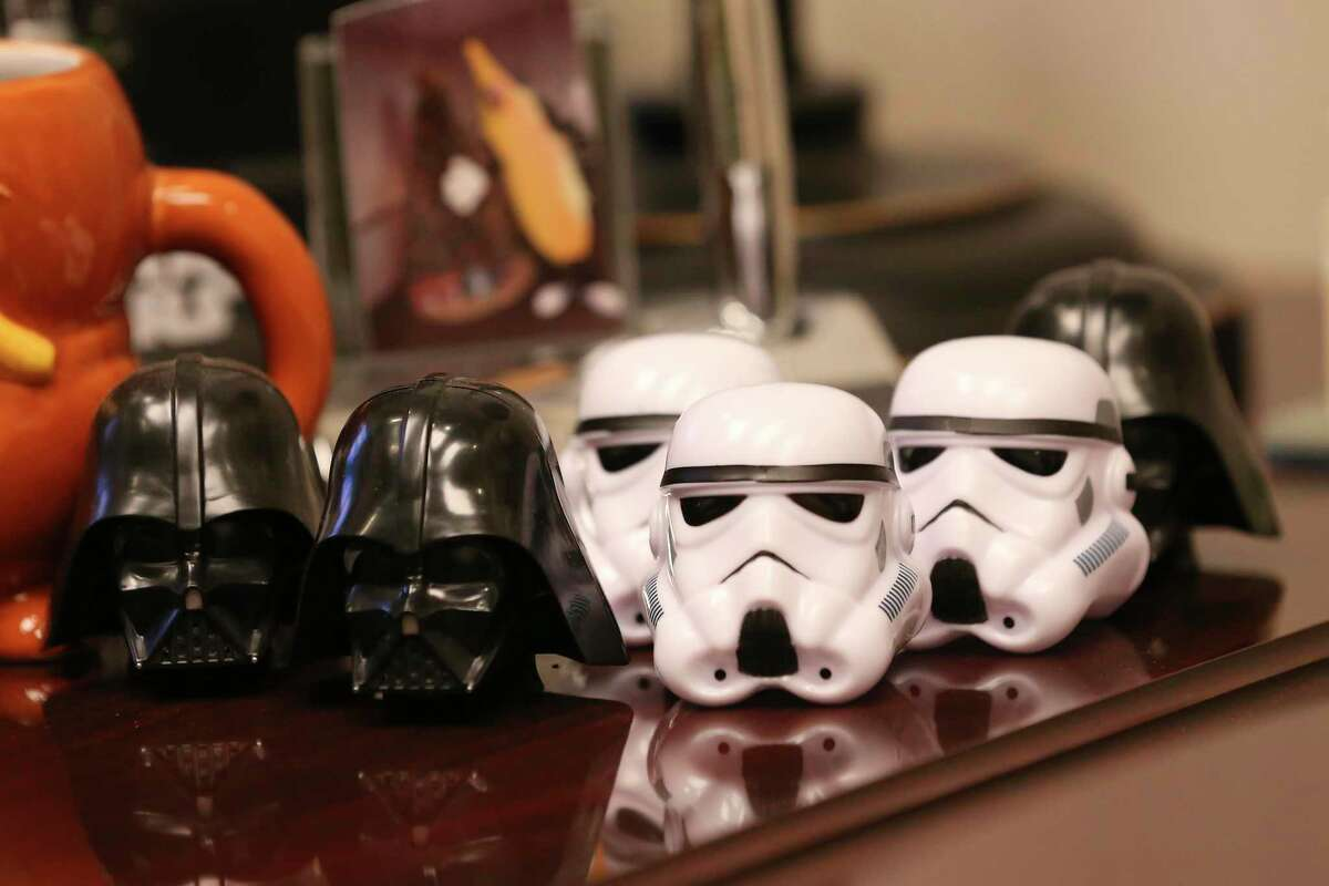 """An avid """"Star Wars"""" fan, San Antonio kidney doctor Sayed Tabatabai keeps miniature Darth Vader and stormtrooper helmets in his office. He sometimes dresses up as Vader for charity events."""