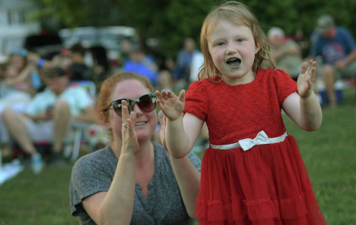 Stratford residents including Ashley Keller and her daughter, Penny Keller, 4, enjoy The Stratford Summer Sunset Concert Series Kick-Off featuring the Oddfellows at Paradise Green, Tuesday, July 21, 2020 in Stratford, Conn. Several wonderful concerts in genres ranging from easy listening to barbershop to doo-wop and rock, are offered by the Stratford Recreation Department every summer at the Green. Attendees bring lawn chairs, their own food and a beverage to enjoy an evening of live music.