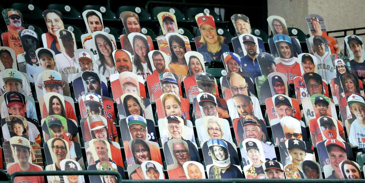 Cardboard cutouts of Houston Astros fans in the Crawford Boxes during an intrasquad game during the Astros summer camp at Minute Maid Park, Wednesday, July 22, 2020, in Houston.
