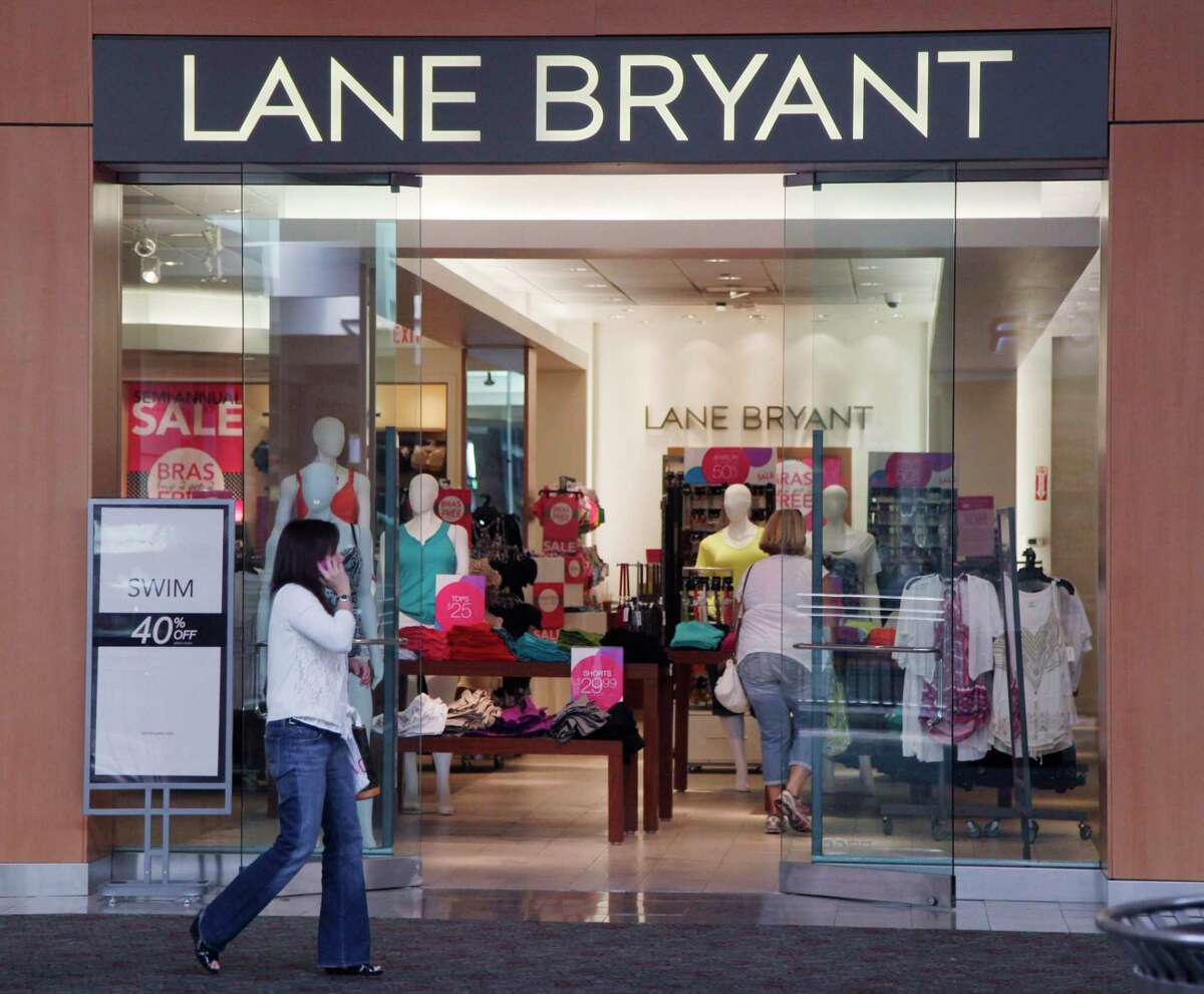 FILE - In this June 15, 2012 file photo, a woman walks past a Lane Bryant store in San Jose, Calif. The operator of Lane Bryant and Ann Taylor filed for Chapter 11 bankruptcy on Thursday, July 23, 2020, the latest retailer to do so during the pandemic. Mahwah, New Jersey-based Ascena Retail Group Inc., which operates nearly 3,000 stores mostly at malls, has been dragged down by debt and weak sales for years.