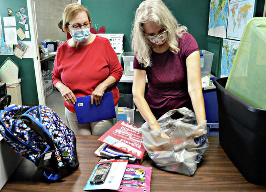 Tina Barnard, left, and Brandi Brace sort through items to be distributed to students on Aug. 8 during the annual school supply drive at Glen-Ed Pantry. Photo: Scott Marion | The Intelligencer