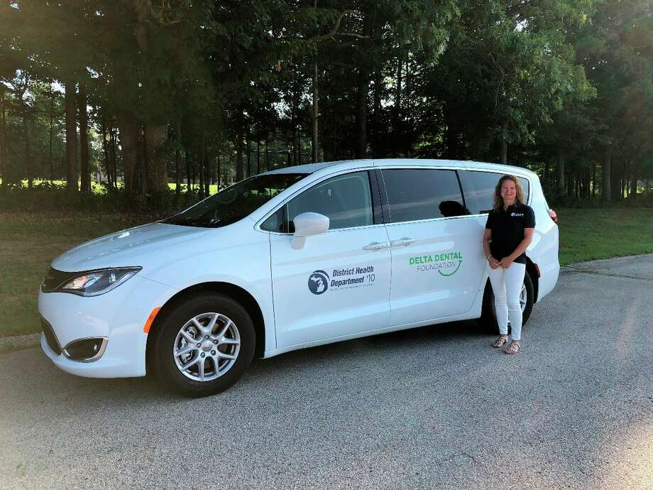 Elizabeth Johnson, DHD#10 Oral Health Coordinator, stands beside newly purchased Dental Outreach van courtesy of a grant funding received from Delta Dental Foundation. (DHD#10/Courtesy photo)
