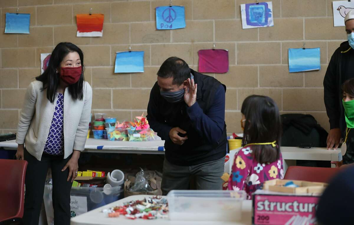 Maria Su, director of the San Francisco Department of Children, Youth and Their Families, and Recreation and Park Department general manager Phil Ginsburg listen to children at the Minnie and Lovie Ward Recreation Center.