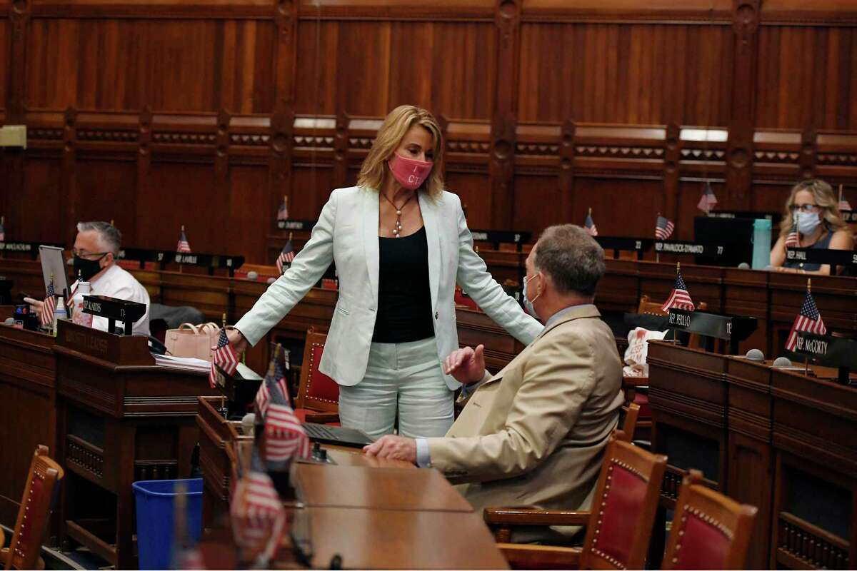 State House Minority Leader Themis Klarides, R-Derby, left, speaks with Rep. John Piscopo, R-Burlington at the Capitol in Hartford on Thursday.