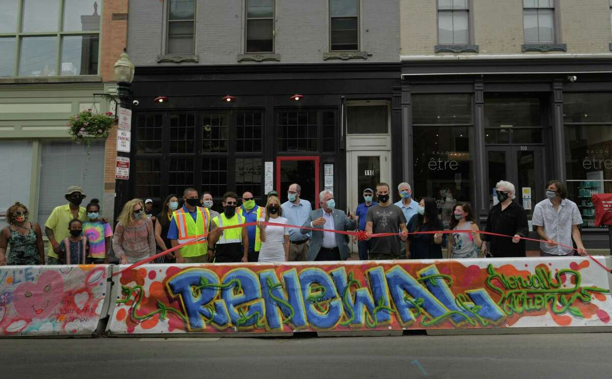 Mayor Rilling meets with the Norwalk Arts Commission and local artists who painted murals on tarps that now cover concrete barriers on Washington Street Thursday, July 23, 2020, in Norwalk, Conn. The barriers were installed to expand outdoor dining space for restaurants during the pandemic and artists painted murals in the theme of
