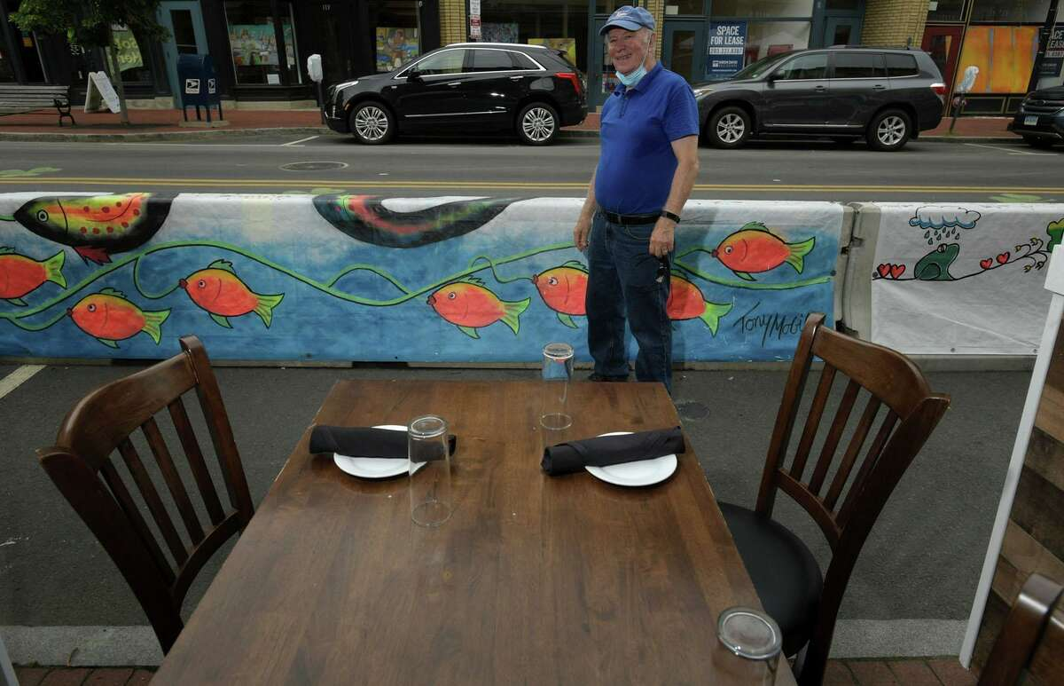 Tony Mobilia, who helped paint murals on tarps that now cover concrete barriers on Washington Street, died on Oct. 9, 2020. Here, he meets for the official tarp unveiling on Thursday, July 23, 2020, in Norwalk, Conn.