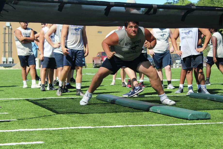 Kingwood began the Cale Melton era with summer strength and conditioning on Monday. Photo: Marcus Gutierrez Staff Photo
