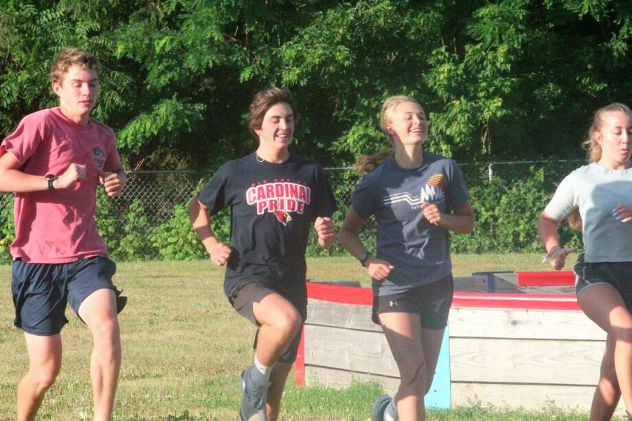 Big Rapids runners work out Monday morning at the Big Rapids Middle School. (Pioneer photo/John Raffel)