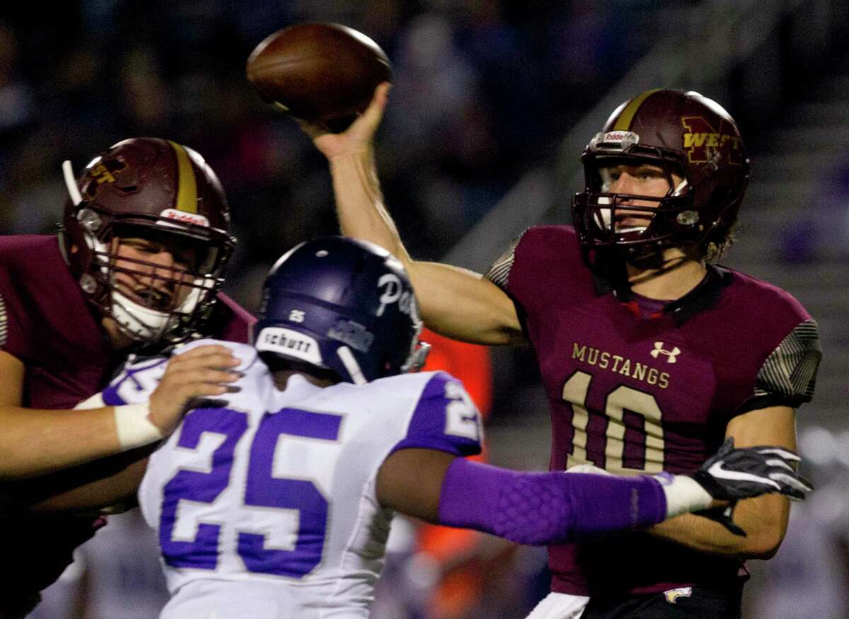 Magnolia West quarterback John Matocha (10) throws under pressure by Lufkin middle linebacker Tony Boykin (25) during the second quarter of a District 8-5A high school football game at Magnolia West High School, Friday, Oct. 26, 2018, in Magnolia.