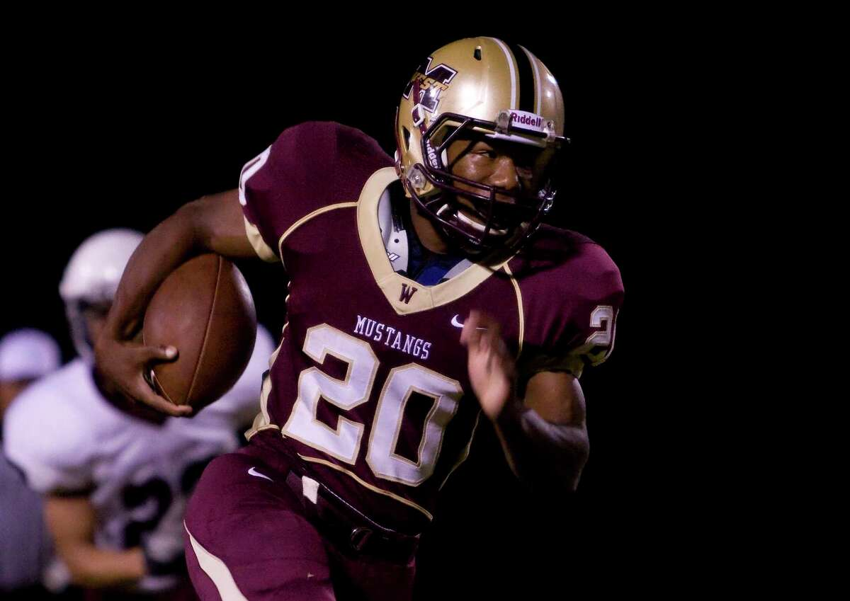 Magnolia TX: Mustang running back Desmond Richards breaks free for the second Mustang score of the game against the Northbrooke Raiders at Mustang Stadium in Magnolia, Texas.