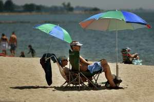 Restricted to Norwalk residents only, beach goers try to beat the heat at Calf Pasture Beach in Norwalk July 20.