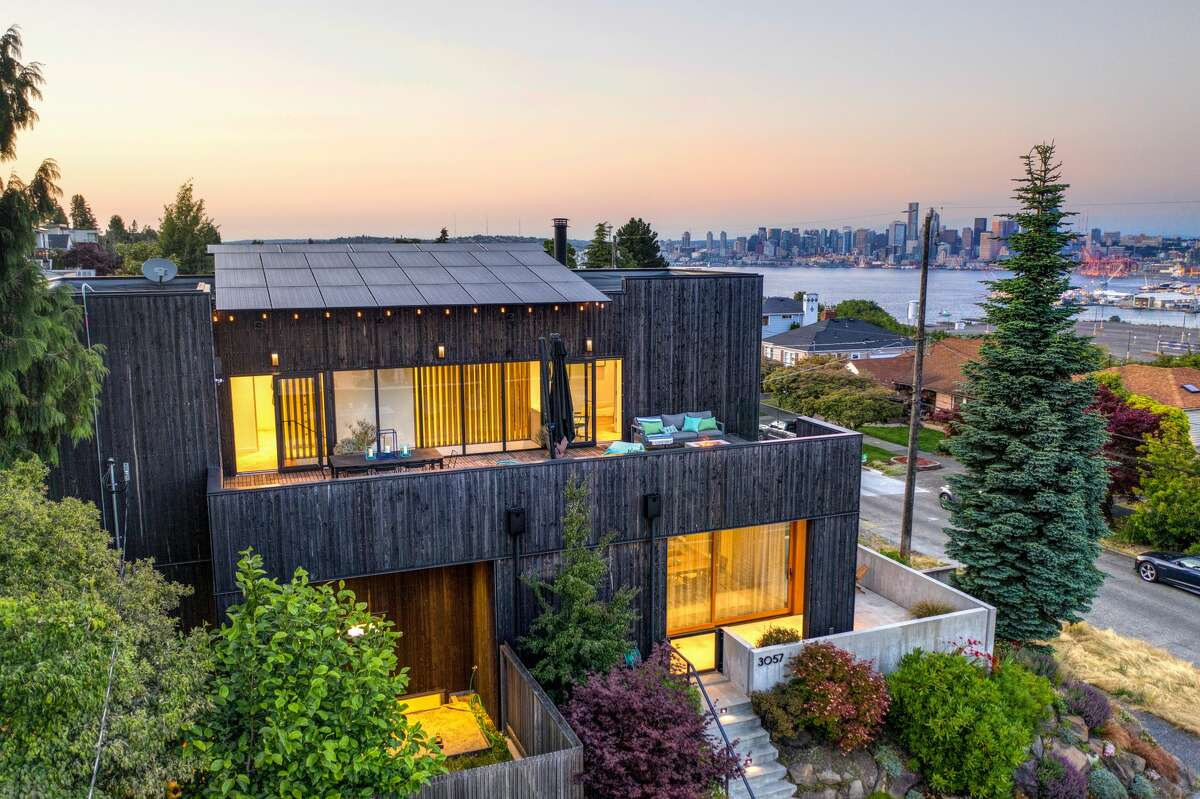 Built in 2014, this water and city skyline view abode is 3,210 square feet of modernity.