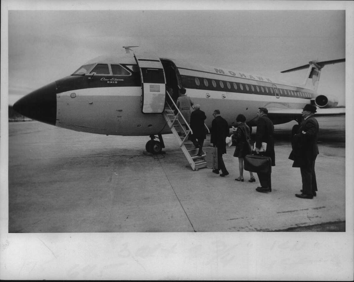 Passengers board Mohawk Airlines flight at Albany, NY airport for first time after 154-day strike by pilots. April 1971 (Bob Paley/Times Union Archive)