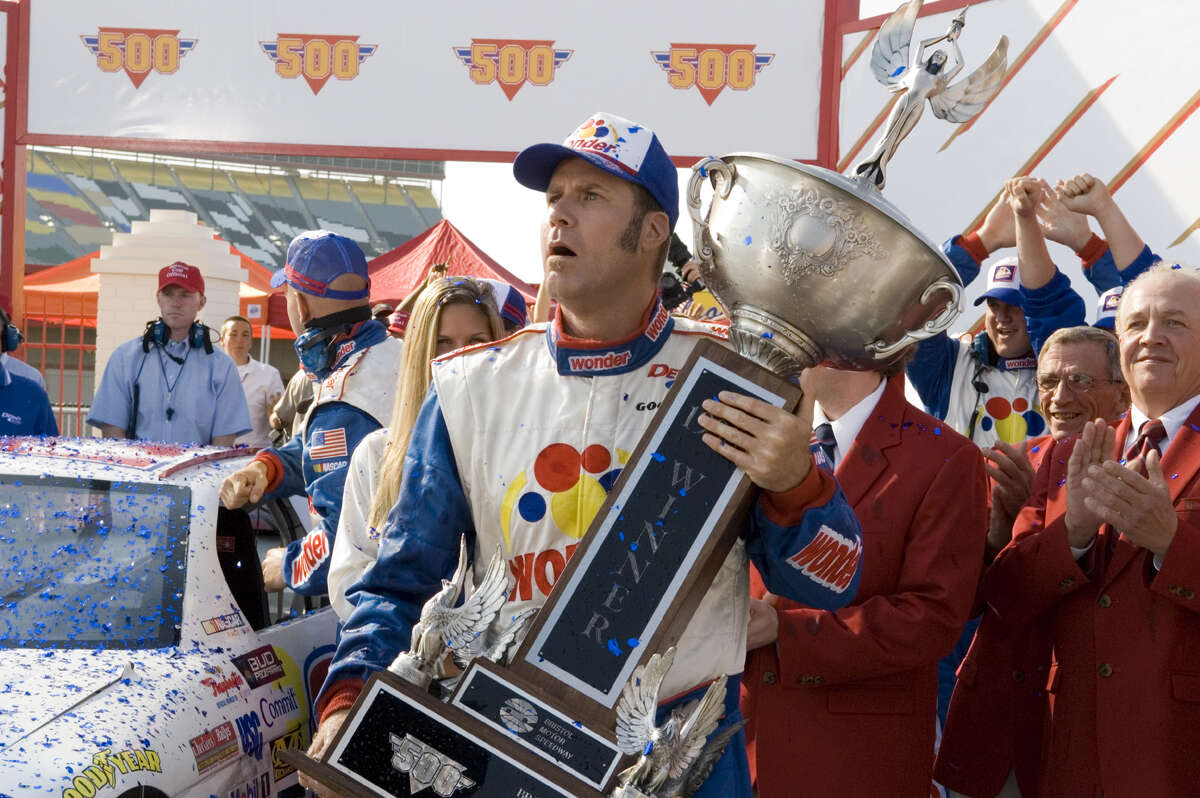 In this photo provided by Columbia Pictures, NASCAR driver Ricky Bobby, played by Will Ferrell, holds a trophy in a scene from ''Talladega Nights: The Ballad of Ricky Bobby.'' (AP Photo/HO,Suzanne Hanover)