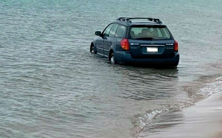 A car was found stuck on the surf at Frankfort Public Beach early morning on July 22. (Courtesy Photo)
