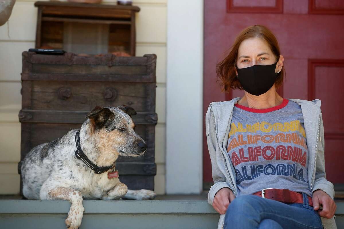 Ann Wees sits for a portrait with her dog, Echo, outside the home where they live on Wednesday, July 22, 2020 in Oakland, Calif.