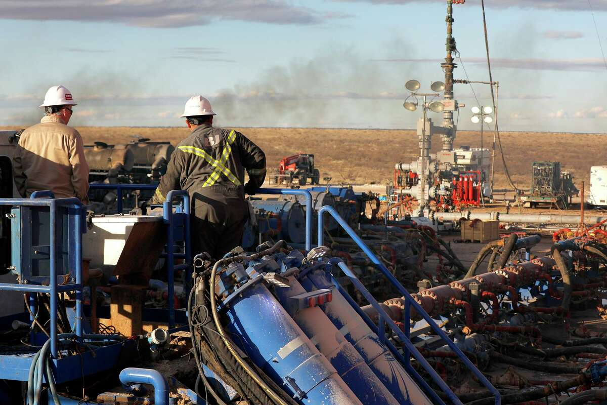 A BJ Services frack crew operates on a well site near Eunice, New Mexico, January 2020. Texas-based oilfield services provider BJ Services filed on Monday for Chapter 11 bankruptcy protection. Houston has been the epicenter of such filings.